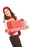 圣诞节:妇女藏品堆被包裹的礼物 免版税库存照片
