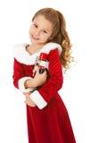 圣诞节:有胡桃钳玩偶的逗人喜爱的女孩 库存图片