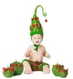 圣诞节婴孩, Xmas树帽子,孩子在Whhite的球玩具 库存图片