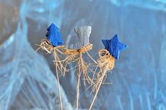 圣诞节结构的星、圣诞树和起动 库存图片