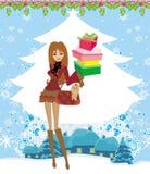 圣诞节购物在一多雪的天 库存照片