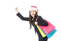 圣诞节购物有快乐礼物的袋子的女商人 免版税库存照片
