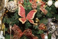 圣诞节蝴蝶,圣诞树的传统装饰, 免版税库存图片