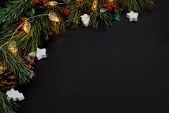 圣诞节 Xmas玩具和云杉的分支在黑背景顶视图 文本的空间 库存图片