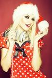 圣诞节dj俏丽女孩微笑 免版税库存图片