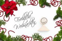 圣诞装饰和德国消息'圣诞快乐的!'为 库存照片