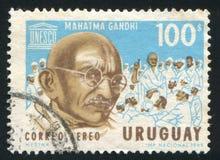 圣雄甘地和联合国科教文组织象征 库存图片