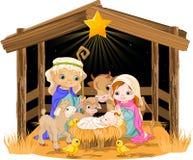 圣洁家庭在圣诞夜里 免版税库存图片