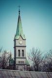 圣洁家庭教会在有十字架的,波兰扎科帕内 库存图片