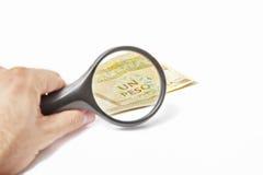 在一一古巴比索的放大镜 免版税库存图片