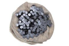 在一个亚麻制袋子的金属钉子 库存图片
