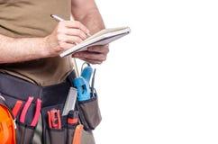 在一个人的建筑传送带有日志笔记本的笔工具传送带建造者 库存照片