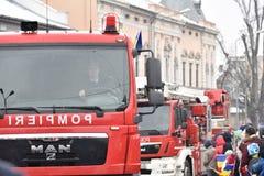 在一个全国事件的消防队员车 库存图片