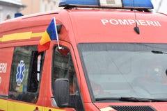 在一个全国事件的消防队员车 免版税库存照片