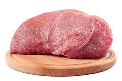 在一个切板的肉在白色背景 库存图片