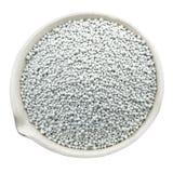 在一个化工瓷杯子的矿物肥料 免版税库存图片