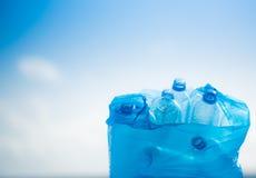 在一个塑料袋的塑料瓶 免版税库存图片