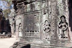 在一个大厦的墙壁上的雕刻在12世纪Ta索马里兰寺庙复合体的 库存照片