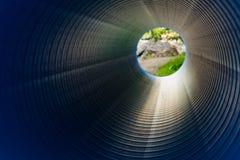 在一个大直径PVC管子里面的看法 库存图片