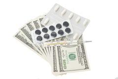 在一个天线罩包装和温度计的药片有美元的 库存照片