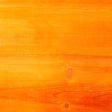 在一个富有的桔子的木织地不很细背景 库存照片