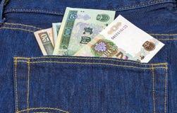 在一个对的后面口袋的中国mone蓝色牛仔裤 免版税库存图片