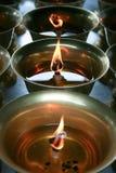 在一个寺庙的佛教油Candels在中国 库存图片