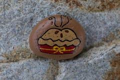 在一个小岩石绘的饼的图片 免版税图库摄影