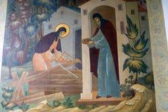 在一个教会门面的宗教绘画在三位一体Sergius拉夫拉在俄罗斯 颜色冬天照片 免版税库存照片