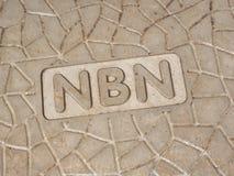 在一个新的路旁坑的NBN字词 免版税库存照片