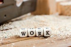 在一个木块写的词工作 库存照片