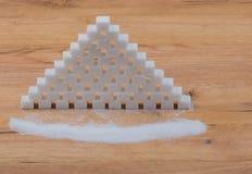 在一个木板堆的糖 免版税库存图片