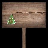 在一个木板的圣诞节绿色杉树 免版税库存图片