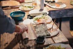 在一个木板的寿司有鱼的11 库存照片