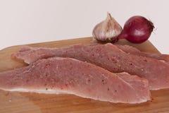 在一个木板的猪肉 免版税库存照片