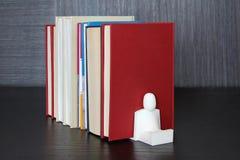 在一个木架子的书 免版税图库摄影