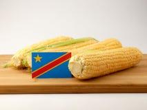 在一个木盘区的刚果民主共和国旗子与惊叹 库存照片