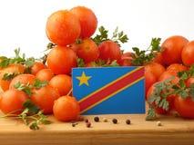 在一个木盘区的刚果民主共和国旗子与汤姆 免版税库存图片