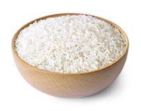 在一个木碗的未加工,被煮半熟的米 图库摄影