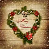 在一个木背景的圣诞节花圈 库存图片