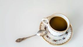 在一个杯子的咖啡在茶碟 免版税库存图片