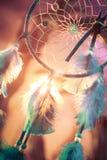 在一个森林的Dreamcatcher日落的 库存图片