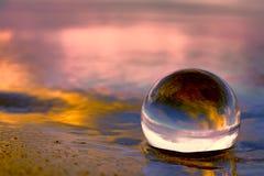 在一个水晶球的日落 免版税库存图片