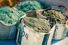 在一个渔船的捕鱼网 免版税库存图片