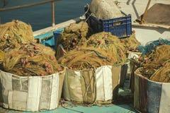 在一个渔船的捕鱼网 免版税库存照片