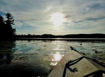 在一个湖的皮船在晚上 免版税图库摄影