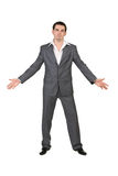 在一个灰色诉讼的生意人 免版税库存照片