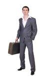 在一个灰色诉讼的生意人 免版税库存图片