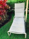 在一个热带地点的躺椅 库存照片