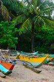在一个热带海滩的渔船 免版税图库摄影